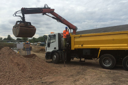 A grab truck delivering loose aggregates