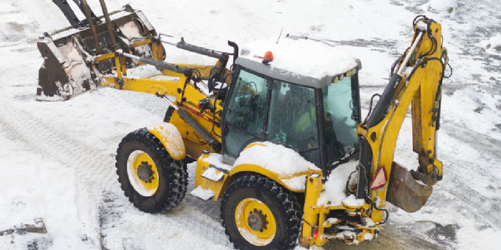 a digger clearing snow